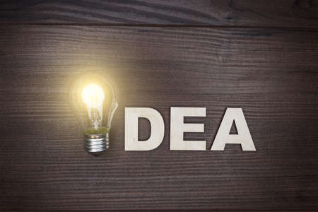 idea concept on the brown wooden background photo