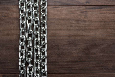 instances: big chains on the brown wooden background Stock Photo