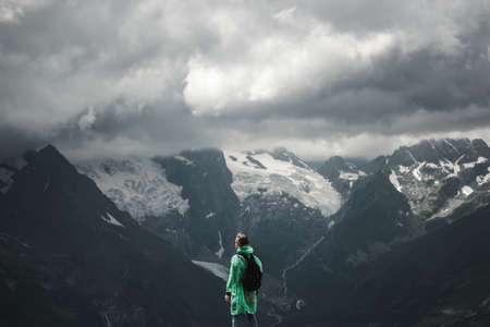 male traveller on the top of mountain stormy landscape photo