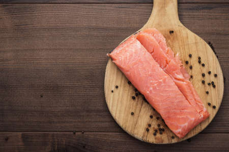 salted trout on the hardboard kitchen table photo