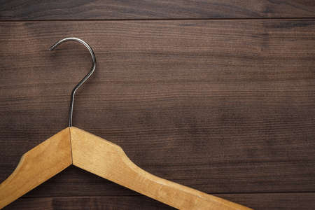 rails: clothing hanger on the brown wooden table