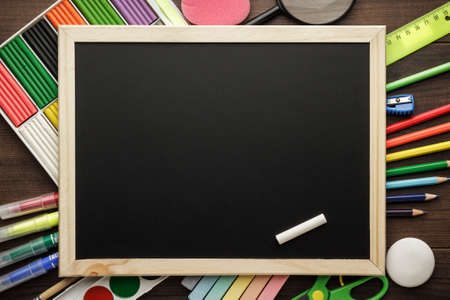school supplies and blackboard with copy space on the table photo