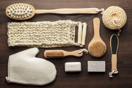 bath sponge: some bath accessories on the brown wooden background Stock Photo