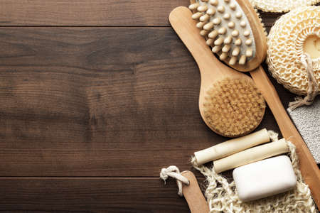 some bath accessories on the brown wooden background Foto de archivo