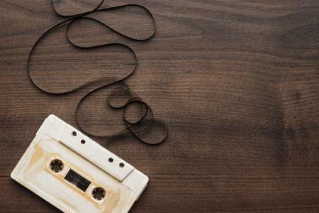 audio cassette: old retro audio cassette over wooden background Stock Photo