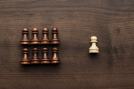 uniqueness: chess uniqueness concept on the wooden background Stock Photo