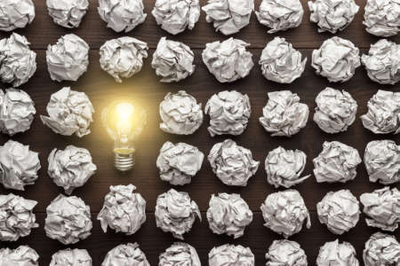 new ideas: new idea concept with crumpled office paper and light bulb Stock Photo