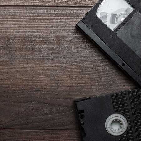 video cassette tape: old retro video tapes on the wooden table