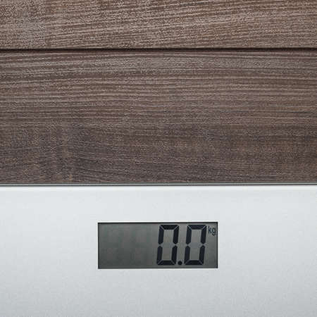 null: grey electronic scales on the wooden floor
