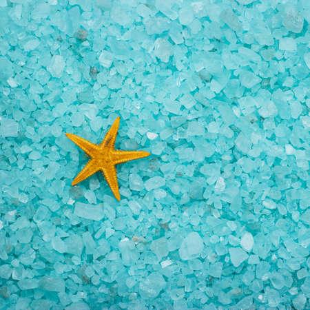 cushion sea star: blue aromatic bath salt and starfish  Stock Photo