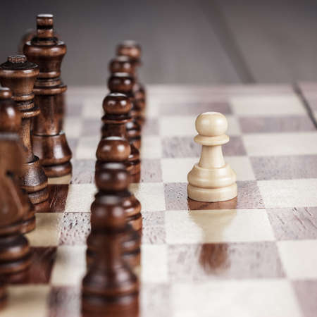 move ahead: chess leadership concept on the wooden chessboard Stock Photo