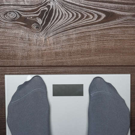 kg: grey electronic scales on the wooden floor