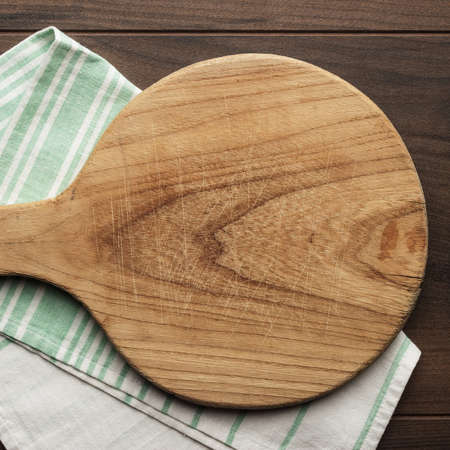 dishcloth: old cutting board and dishcloth on the wooden table Stock Photo