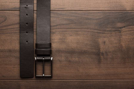 brown leather belt for men on wooden table 免版税图像