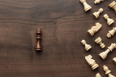 think different: chess uniqueness concept on the wooden background Stock Photo
