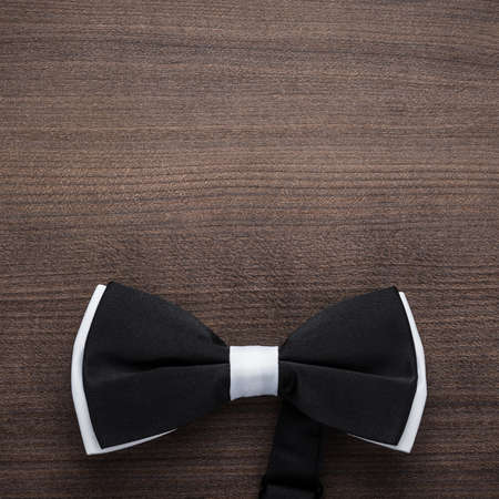 prom: black and white bow tie on wooden table