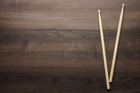 drum sticks: pair of wooden drumsticks on wooden table Stock Photo