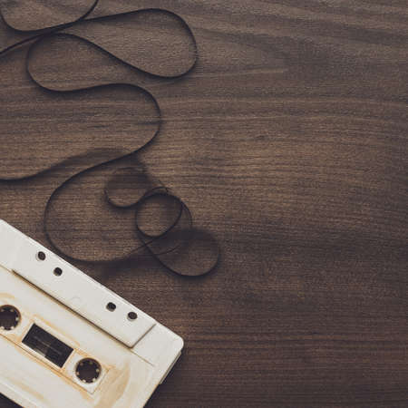 audio cassette: old retro audio cassette over wooden background Stock Photo