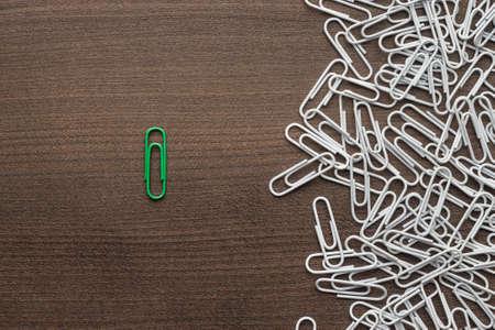 bright green paper clip unique idea concept