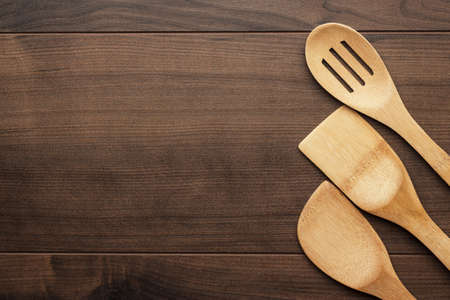 different wooden kitchen tools on the table with copy space photo