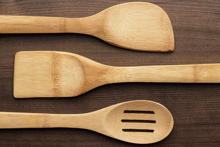 different wooden kitchen tools on the table photo