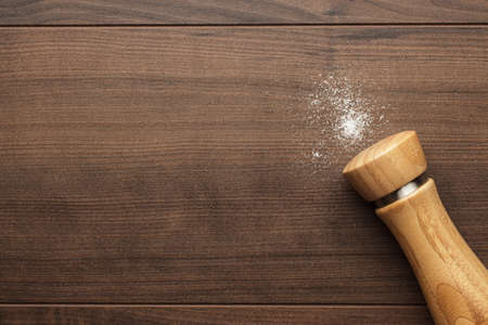 salt shaker: wooden salt shaker on the brown table Stock Photo