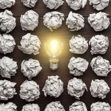 paper notes: new idea concept with crumpled office paper and light bulb Stock Photo