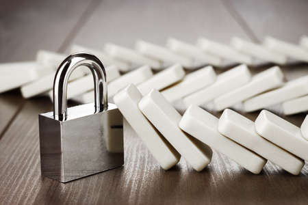 strong: padlock standing still reliability concept on wooden table Stock Photo