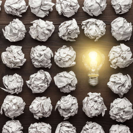 new idea concept with crumpled office paper and light bulb Stock Photo