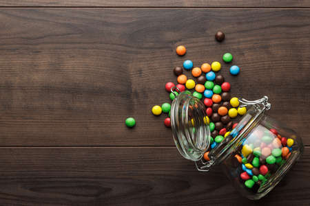 topple: topple over glass jar full of colorful sweets