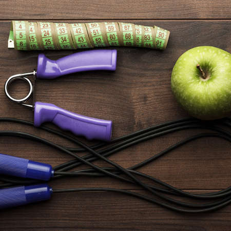 training device: different workout objects on the brown wooden table