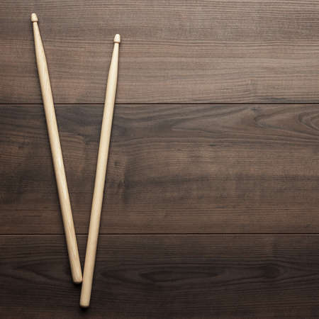 drumsticks: pair of wooden drumsticks on wooden table Stock Photo