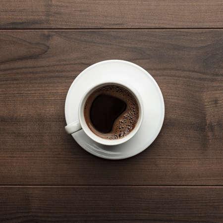 Bureau tafel met kopje koffie overhead
