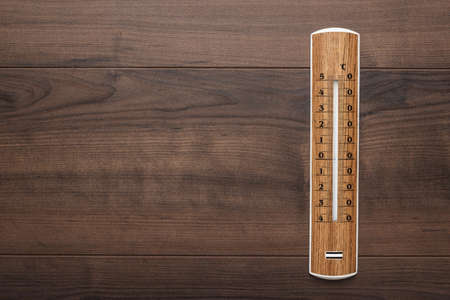 termometer: wooden thermometer on the brown table background Stock Photo