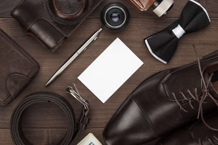 men's accessories on the brown wooden table Stock Photo