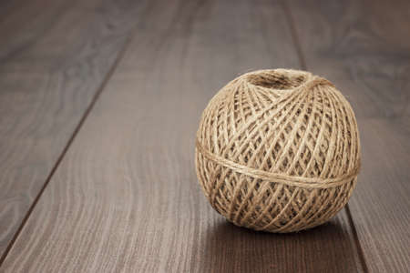 durable: reel of durable thread on the wooden table