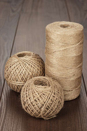 durable: reel and balls of durable thread on the wooden table