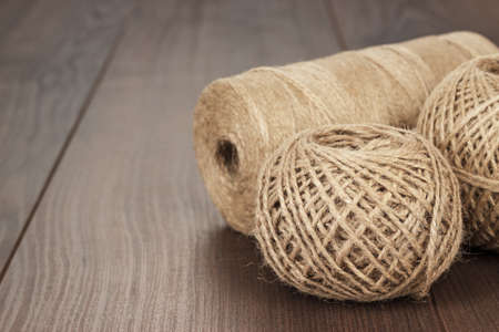 durable: reels and balls of durable thread on the wooden table