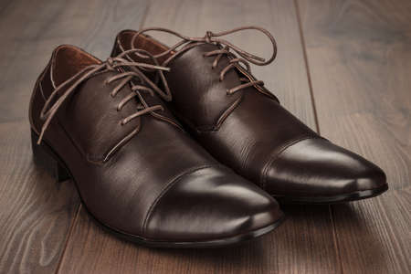 brown leather shoes on the wooden background Stock Photo