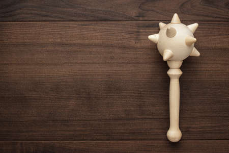 mace: handmade wooden toy mace on the table