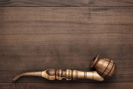 wooden handmade: wooden handmade smoking pipe on the table