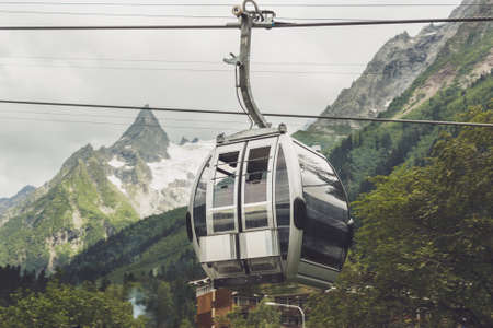 dombay: cableway cabin in the mountains. alpine landscape