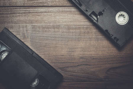 videocassette: old retro video tape on the wooden background