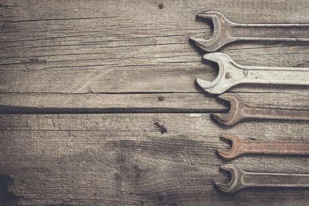 screw key: old rusty screw keys on the wooden table