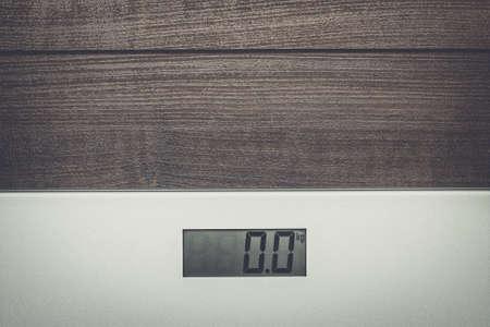 weigher: scales on the wooden floor