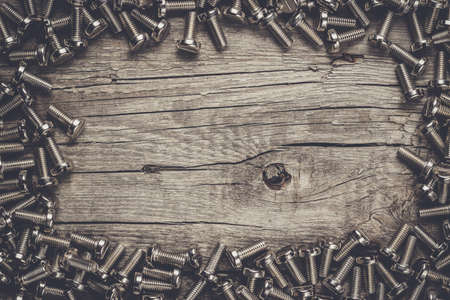 gudgeon: new bolts on the wooden table background