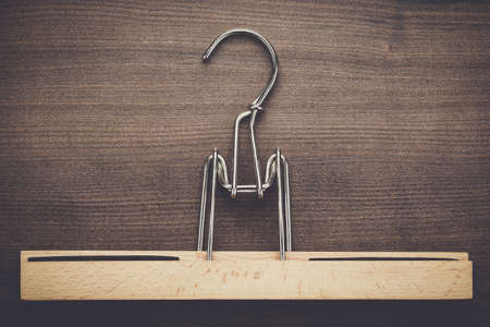 clothes rail: clothing hanger on the brown wooden table
