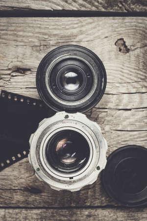 negative film: retro camera lenses and negative film on wooden table