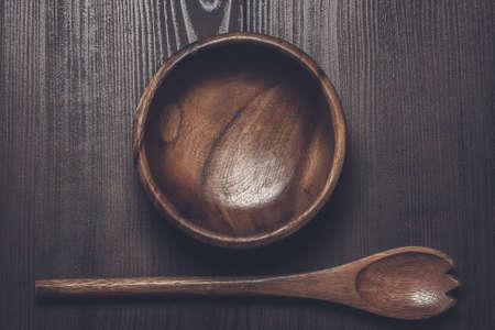 salad bowl: wooden salad bowl and spoon on brown table