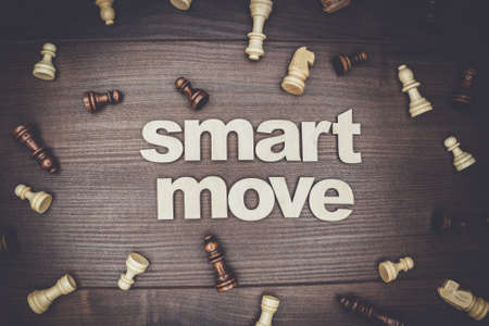 on the move: smart move concept on the brown wooden background Stock Photo